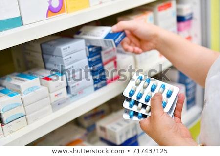 Eczane sağlık tıp hemşire şişe ilaçlar Stok fotoğraf © Ariusz
