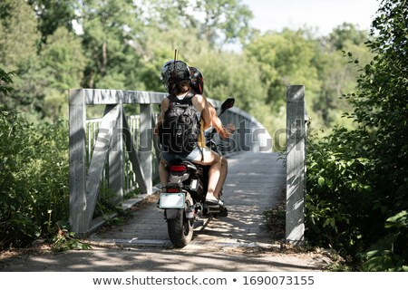 Young couple on a moped by a river Stock photo © photography33