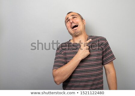 Surprised man with extended right hand Stock photo © pablocalvog