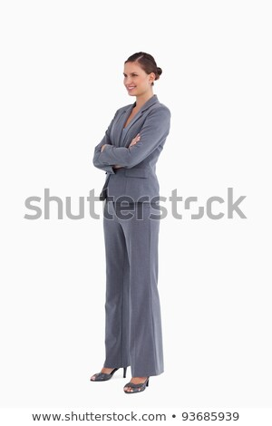 Side view of a woman with arms crossed against a white background Stock photo © wavebreak_media