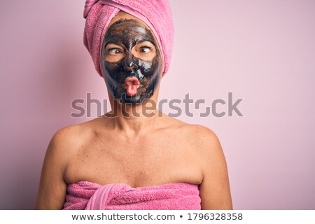 Woman with pink lips wearing a black mask Stock photo © wavebreak_media