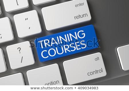 keyboard with training and development button stock photo © tashatuvango