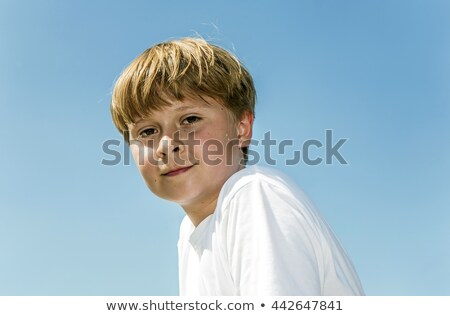 happy boy is smiling sweating from sports and enjoying life stock photo © meinzahn