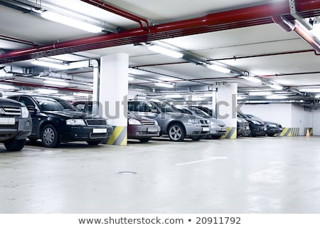 Stock photo: Underground Parking Garage With Moving Car