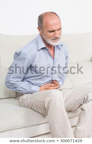 歳の男性 腹 痛み ベッド 家 ストックフォト © wavebreak_media