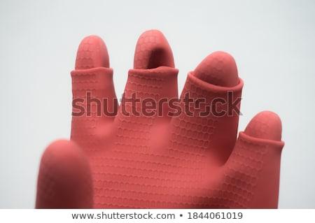 Furcsa kéz piros kesztyű Stock fotó © Stocksnapper