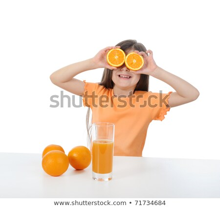 Young girl playing with oranges and drinking orange juice Stock photo © photography33