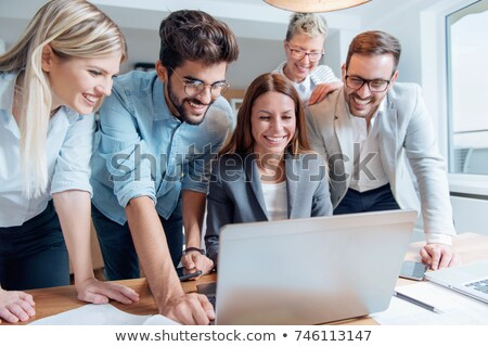 Business team working with tablet computer. Stock photo © Kurhan