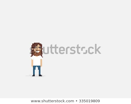 young man with long beard in an overcoat smiling Stock photo © feedough