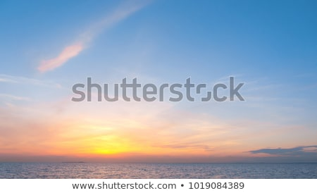 Fiery sunrise sky on summer sea Stock photo © BSANI