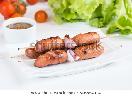 small wiener sausages on white plate stock photo © stevanovicigor