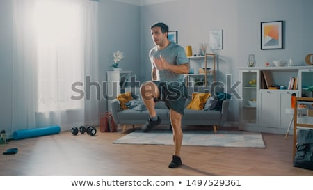 man in exercise room Stock photo © ssuaphoto