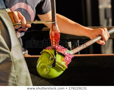 Glass blower works on ornate green bottle Stock photo © backyardproductions