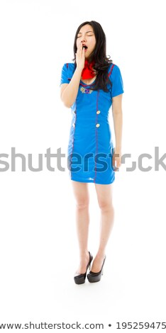 Asian air stewardess yawning with hand over mouth Stock photo © bmonteny