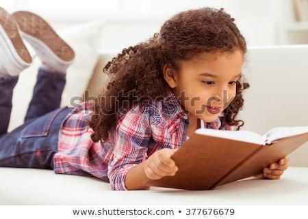 девушки чтение диван улыбаясь довольно брюнетка Сток-фото © feelphotoart