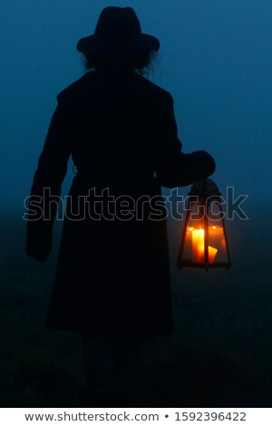 Woman holding lantern with candle Stock photo © dariazu