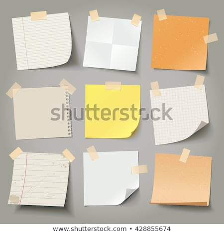 Old vintage yellowing notepaper stuck to a white background. Stock photo © latent