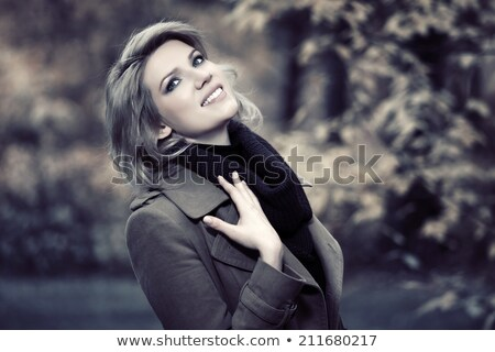 Séduisant jeunes blond femme rêvasser Photo stock © dash
