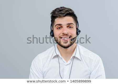 young businesswoman with headset on white background studio Stock photo © ambro