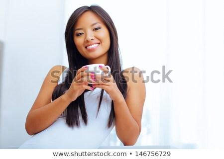 Jonge mooie asian vrouw beker Stockfoto © deandrobot