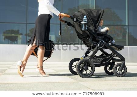 Karrier anyaság vonzó fiatal anya ül Stock fotó © nyul