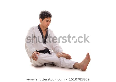 Asian fit man posing his muscles on black background Stock photo © deandrobot
