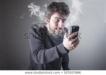 Angry man on phone Stock photo © tangducminh