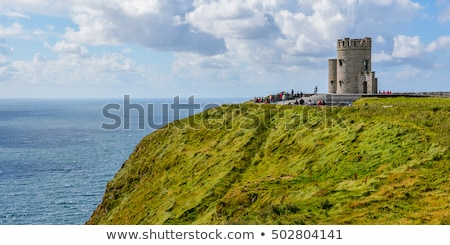 Famous cliffs of Moher with tower. Ireland Stock photo © Perszing1982