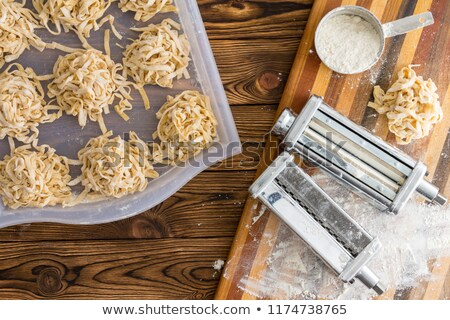 Homemade fettuccine pasta drying on a metal tray Stock photo © ozgur