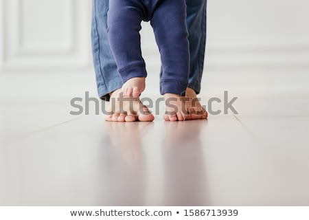 Bare Feet of a Young Woman on Blue Bed Stock photo © juniart