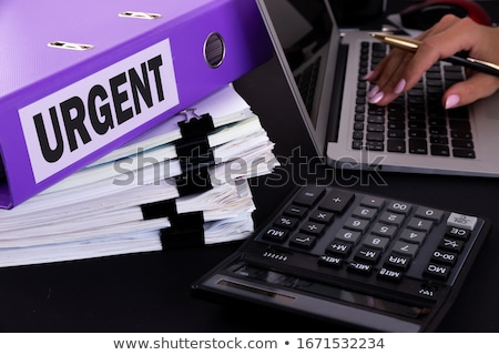 urgent concept with word on folder stock photo © tashatuvango