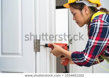 process of wood door hinge installation. Stock photo © stryjek