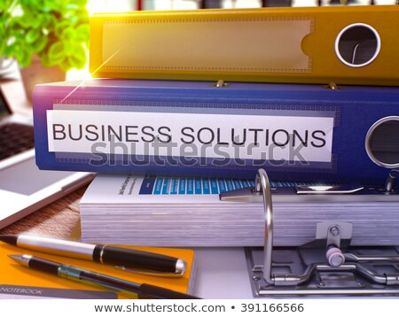 red ring binder with inscription business solutions stock photo © tashatuvango