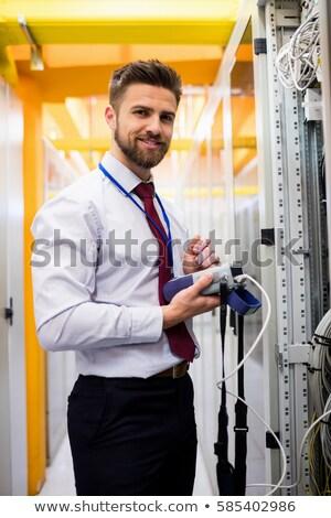 Mosolyog technikus digitális kábel szerver nagy Stock fotó © wavebreak_media