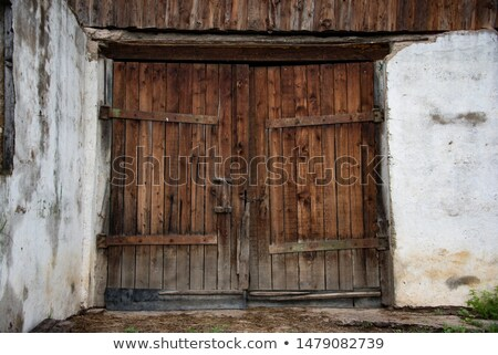 Old door in a wooden shed Stock photo © michaklootwijk