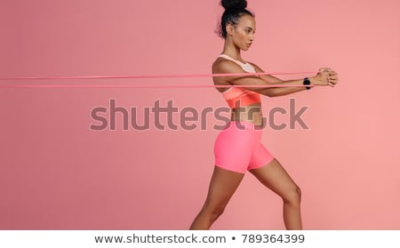 Sports woman stretching hands Stock photo © deandrobot