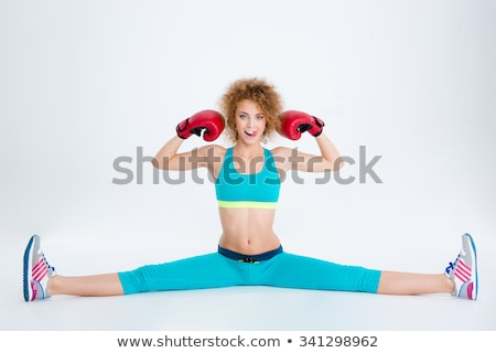 Sports woman in boxing gloves doing twine Stock photo © deandrobot