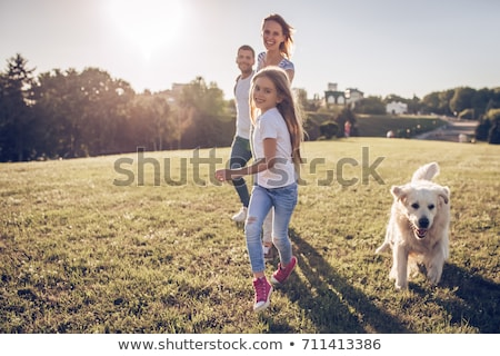 Stock fotó: Happy Family With Dog At Sunset