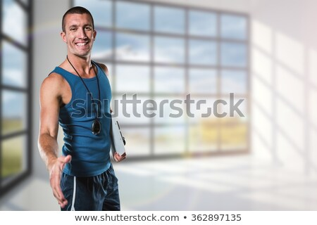 Foto stock: Composite Image Of Happy Personal Trainer Giving Handshake