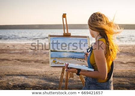 Mulher jovem cavalete feliz pintar arte educação Foto stock © OleksandrO