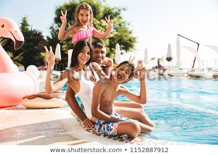 girl with rubber ring near swimming pool stock photo © bezikus