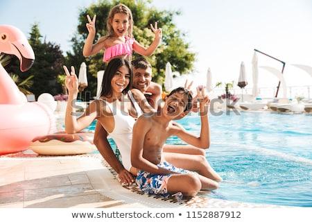 Girl with rubber ring near swimming pool Stock photo © bezikus