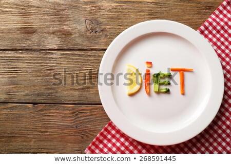 Fitness word on plate Stock photo © fuzzbones0