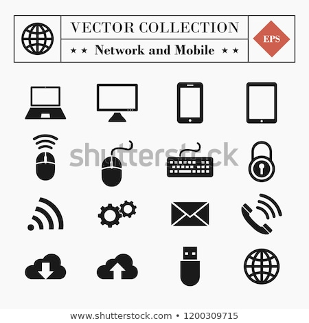 Stock photo: World Globe On A Mobile Phone On A Computer Keyboard