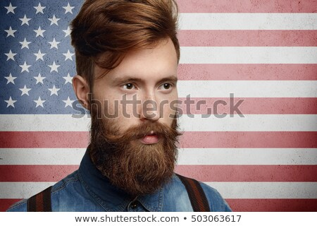 Handsome man proudly wearing white shirt with USA flag Stock photo © stevanovicigor
