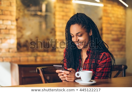 a black young girl reading stock photo © bluering