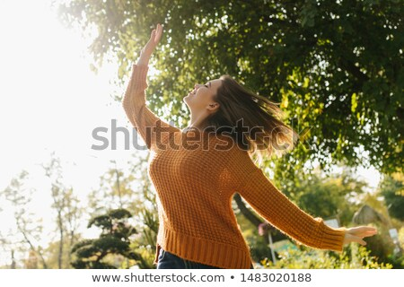 Stok fotoğraf: Pretty Young Brunette Dancing In The Park