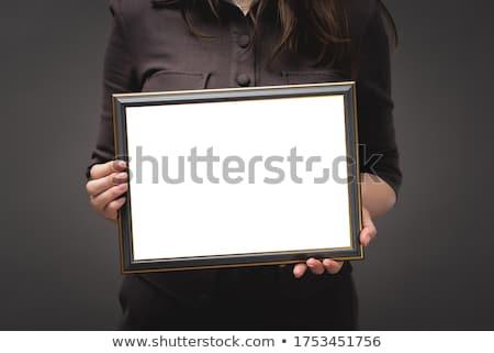 Business woman holding blank diploma certificate Stock photo © stevanovicigor