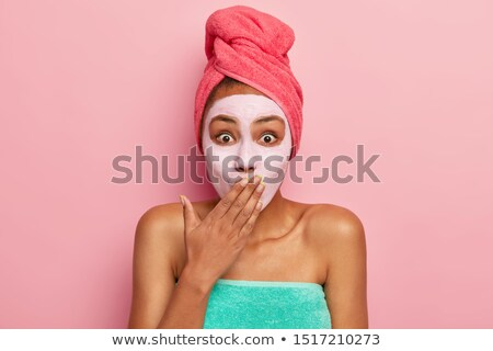 Incredible woman standing and posing over pink background Stock photo © deandrobot