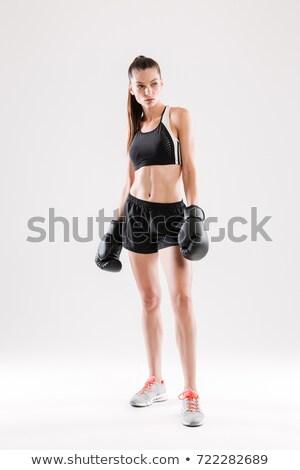 Grave deportes mujer boxeador pie blanco Foto stock © deandrobot